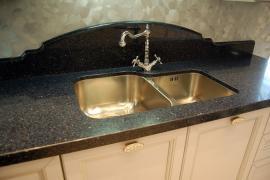 Countertops made of quartz. Veneered mabley plumbing