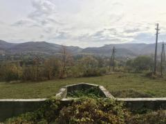 Plot in the Carpathians with a view of the mountains and the forest. There is a Foundation